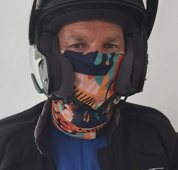 Neck tube under motorcycle helmet